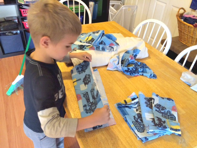 When my son saw the Transformers napkins he volunteered to fold them. Score #2!