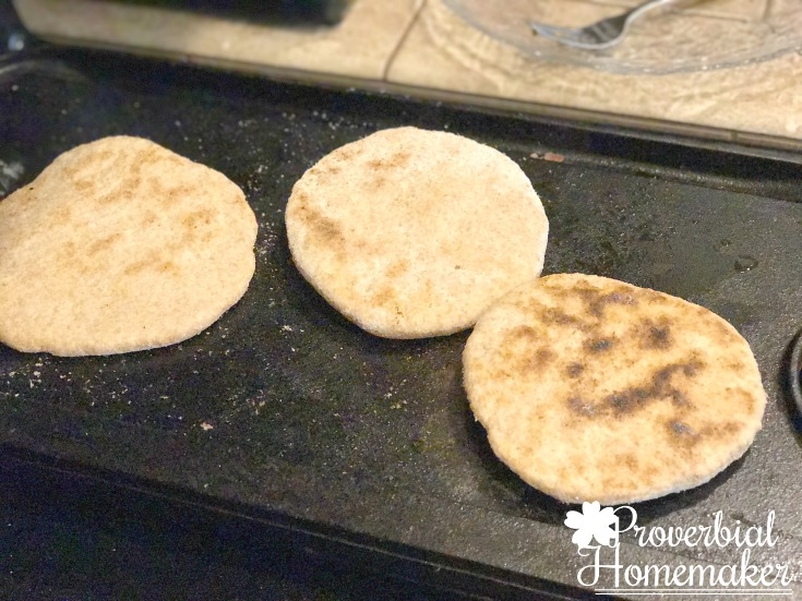 Using a cast iron griddle to brown the dough for this easy flatbread recipe.