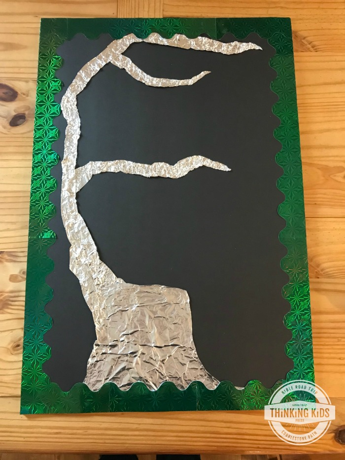 Using foil to create the stump of Jesse for a Names of Jesus ornaments poster that goes with the Jesse Tree